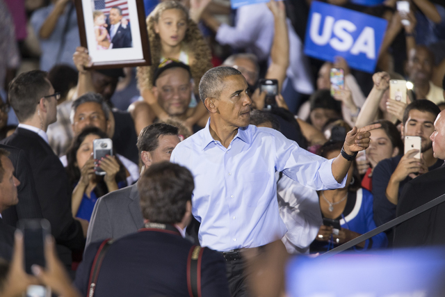 President Barack Obama gestures as he steps down from the stage after his speech during a campaign rally for Democratic presidential nominee Hillary Clinton at Cheyenne High School on Sunday, Oct. ...