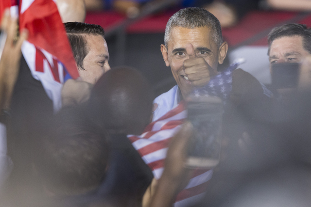 President Barack Obama greets supporters after his speech during a campaign rally for Democratic presidential nominee Hillary Clinton at Cheyenne High School on Sunday, Oct. 23, 2016, in North Las ...