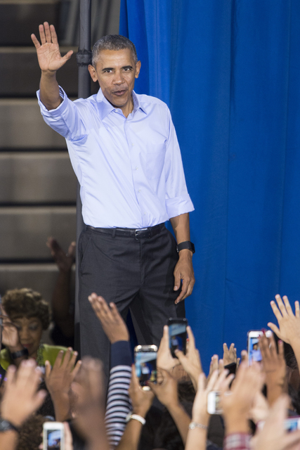 President Barack Obama waves to the crowd at the end of his speech during a campaign rally for Democratic presidential nominee Hillary Clinton at Cheyenne High School on Sunday, Oct. 23, 2016, in  ...