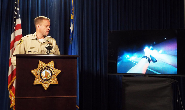 An officer body-worn camera video is displayed as Metro Undersheriff Kevin McMahill speaks during a news conference at Metropolitan Police headquarters, Monday, Oct. 17, 2016, regarding a fatal of ...