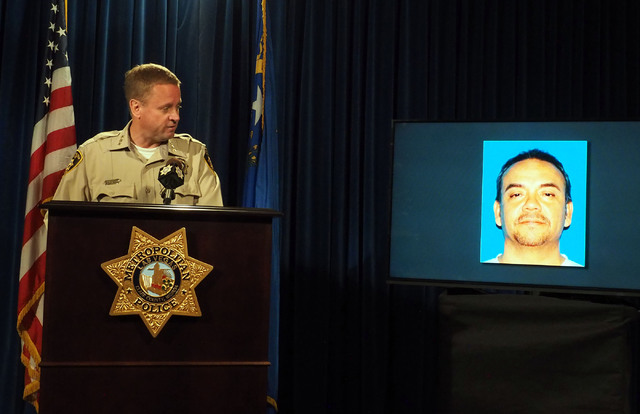 Metro Undersheriff Kevin McMahill looks at a photo of Rex Vance Wilson during a news conference at Metropolitan Police headquarters, Monday, Oct. 17, 2016, regarding a fatal officer involved shoot ...