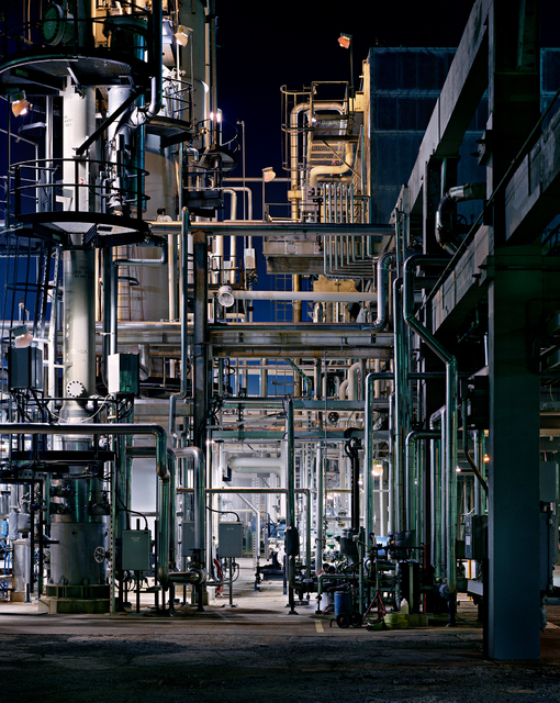 Pipes form geometric patterns inside an oil refinery in St. John, New Brunswick, in an image shot by award-winning Canadian photographer Edward Burtynsky in 1999. More than 50 Burtynsky images ins ...