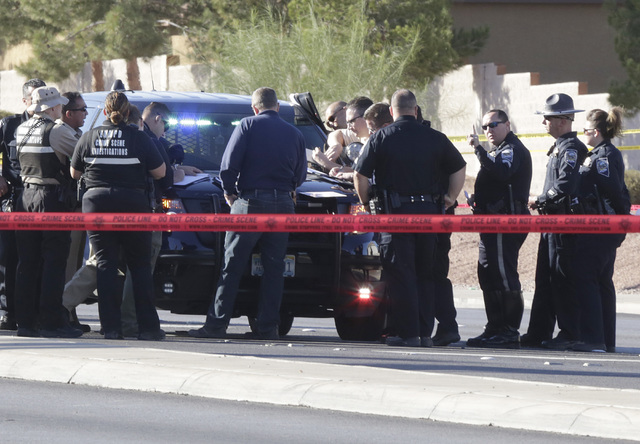 Police investigating an officer-involved shooting after a Nevada Highway Patrol trooper shot a suspect Wednesday, Oct. 19, 2016, after a car chase in Henderson. (Bizuayehu Tesfaye/Las Vegas Review ...