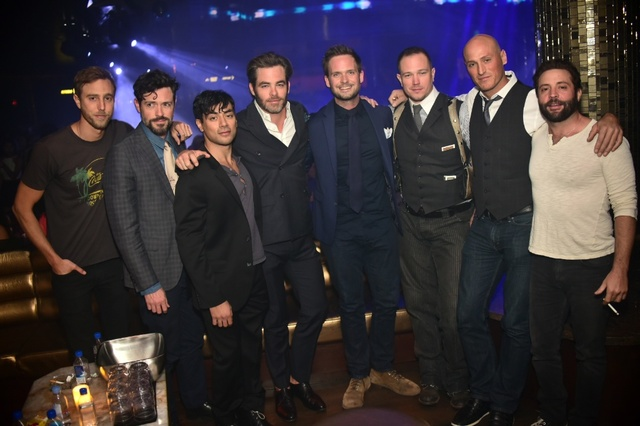 At club Omnia Friday, Patrick J. Adams (fifth from left) with Chris Pine (fourth from left) and Brendan Hines (second from left). (Aaron Garcia)