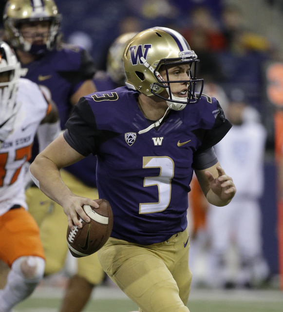 Washington quarterback Jake Browning in action against Oregon State in an NCAA college football game Saturday, Oct. 22, 2016, in Seattle. (Elaine Thompson/AP)