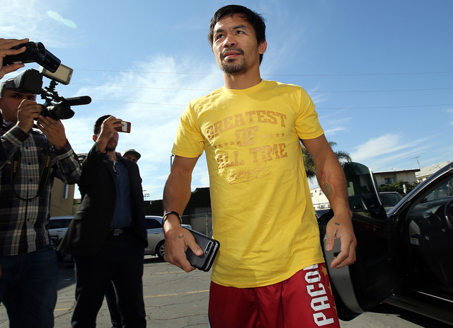 Manny Pacquiao arrives for his Los Angeles media day last week. (Photo by Mikey Williams)