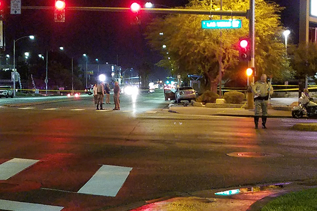 Las Vegas police investigate a fatal auto-pedestrian accident at Charleston and Las Vegas boulevards, Wednesday, Oct. 26, 2016. A woman was hit and killed and a man was injured. (Mike Shoro/Las Ve ...