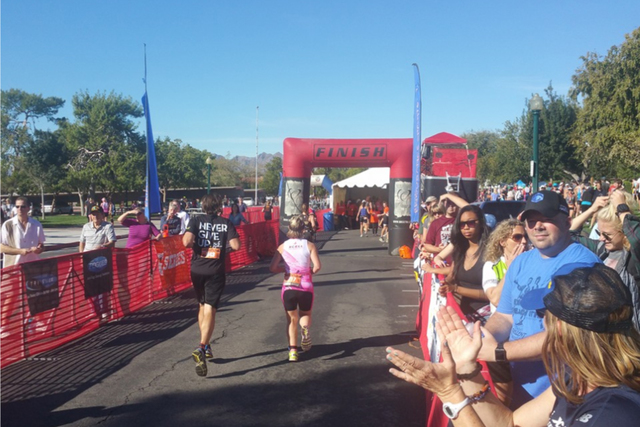 Participants run toward the finish line during the 2015 Pumpkinman triathlon event in Boulder City. This year's event is expected to draw more than 1,000 participants. (BBSC Endurance Sports)