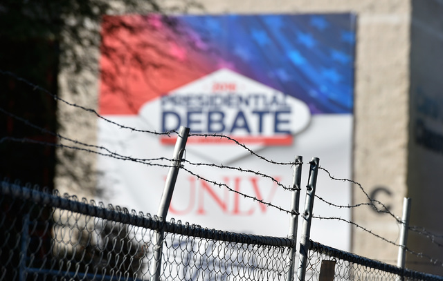 A temporary fence topped with barbed wire is seen on campus at UNLV Monday, Oct. 17, 2016, in Las Vegas. The added security with perimeter fencing was set for the third and final presidential deba ...