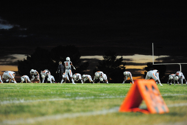 The Chaparral football team warms up before the Virgin Valley High School Chaparral High School High School game at Virgin Valley High School in Mesquite, Nev., on Friday, Oct. 14, 2016. Brett Le  ...