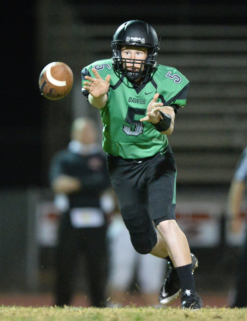 Virgin Valley quarterback Cade Anderson (5) tosses the ball to a teammate during the Virgin Valley High School Chaparral High School High School game at Virgin Valley High School in Mesquite, Nev. ...