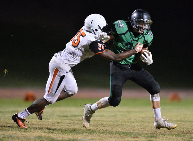 Virgin Valley running back Maurice Jayden Perkins (33) tries to shed a tackler during the Virgin Valley High School Chaparral High School High School game at Virgin Valley High School in Mesquite, ...