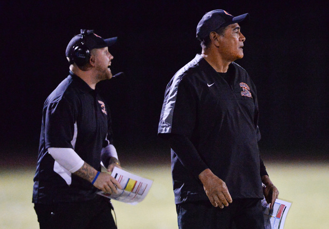 Chaparral head coach Phil Nahipali, right, watches his team play during the Virgin Valley High School Chaparral High School High School game at Virgin Valley High School in Mesquite, Nev., on Frid ...