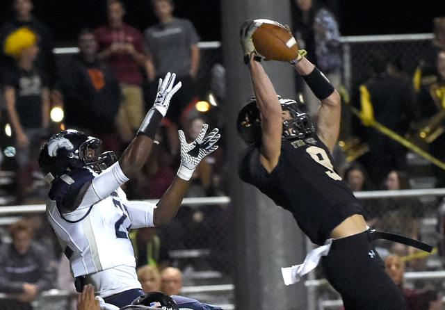 Faith Lutheran's Keagan Touchstone (9) intercepts the ball against Shadow Ridge's Aubrey Nellems during a high school football game at Faith Lutheran High School, Friday, Oct. 21, 2016, in Las Veg ...