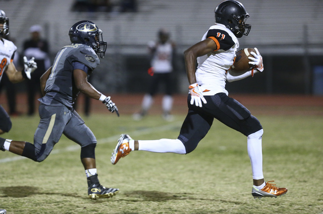 Chaparral's Kentrell Petite (11) runs the ball to score a touchdown against Cheyenne during a football game at Cheyenne High School in Las Vegas on Thursday, Oct. 27, 2016. Chase Stevens/Las Vegas ...