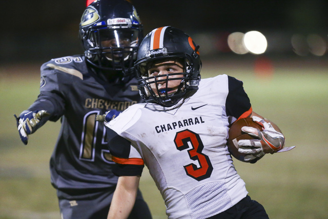 Chaparral's Julius Hernandez (3) gets past Cheyenne's Anthony Walker (15) during a football game at Cheyenne High School in Las Vegas on Thursday, Oct. 27, 2016. Chase Stevens/Las Vegas Review-Jou ...