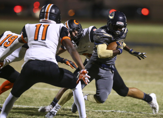 Cheyenne's Corwin Bush (6) drives the ball against Chaparral during a football game at Cheyenne High School in Las Vegas on Thursday, Oct. 27, 2016. Chase Stevens/Las Vegas Review-Journal Follow @ ...