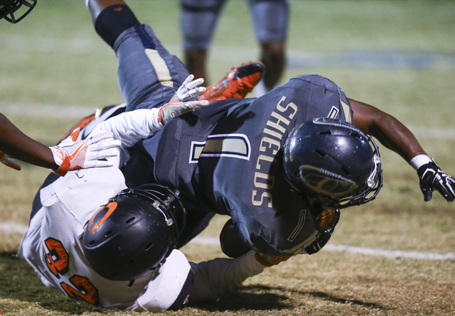 Cheyenne's Christian Thomas-Fulton (1) is tackled by Chaparral's Trayvius Hodge (32) during a football game at Cheyenne High School in Las Vegas on Thursday, Oct. 27, 2016. Chase Stevens/Las Vegas ...