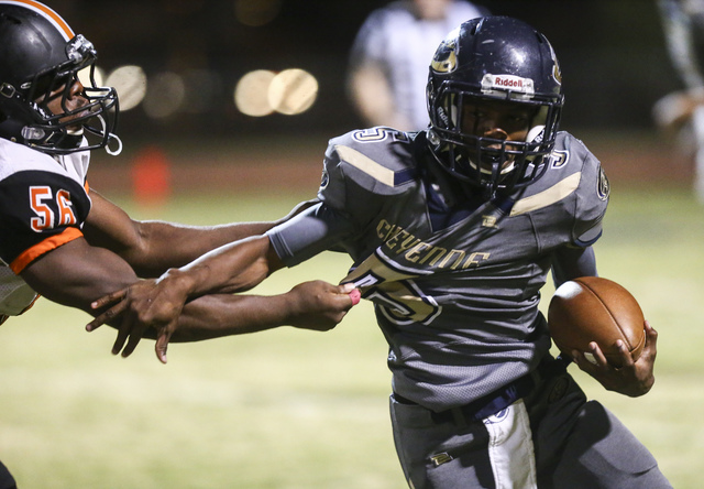 Cheyenne's Deriontae Green (5) looks to get past Chaparral's Alexander Jones (56) during a football game at Cheyenne High School in Las Vegas on Thursday, Oct. 27, 2016. Chase Stevens/Las Vegas Re ...