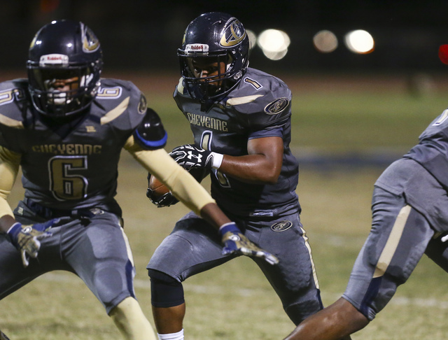 Cheyenne's Christian Thomas-Fulton (1) drives the ball against Chaparral during a football game at Cheyenne High School in Las Vegas on Thursday, Oct. 27, 2016. Chase Stevens/Las Vegas Review-Jour ...