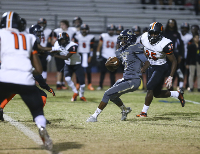 Cheyenne's Deriontae Green (5) looks to get past Chaparral's Shawn Nelson (35) during a football game at Cheyenne High School in Las Vegas on Thursday, Oct. 27, 2016. Chase Stevens/Las Vegas Revie ...