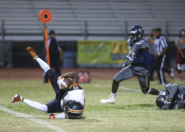 Chaparral's Kentrell Petite (11) is tripped up by Cheyenne defense during a football game at Cheyenne High School in Las Vegas on Thursday, Oct. 27, 2016. Chase Stevens/Las Vegas Review-Journal Fo ...
