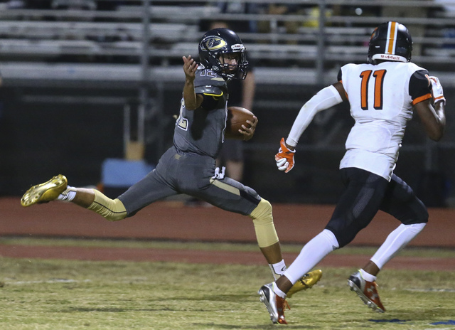 Cheyenne's Matthew LaBonte (12) looks to get past  Chaparral's Kentrell Petite (11) during a football game at Cheyenne High School in Las Vegas on Thursday, Oct. 27, 2016. Chase Stevens/Las Vegas  ...