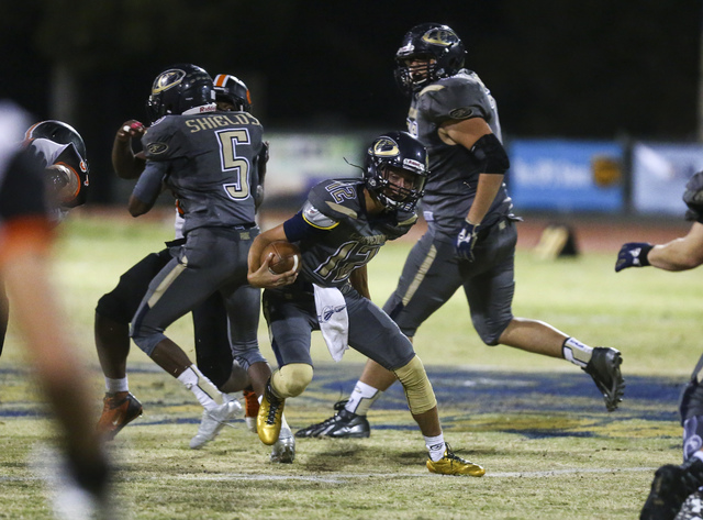Cheyenne's Matthew LaBonte (12) drives the ball against  Chaparral during a football game at Cheyenne High School in Las Vegas on Thursday, Oct. 27, 2016. Chase Stevens/Las Vegas Review-Journal Fo ...