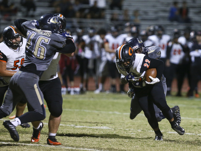 Chaparral's Adan Bernal (22) is tackled by Cheyenne defense during a football game at Cheyenne High School in Las Vegas on Thursday, Oct. 27, 2016. Chase Stevens/Las Vegas Review-Journal Follow @c ...