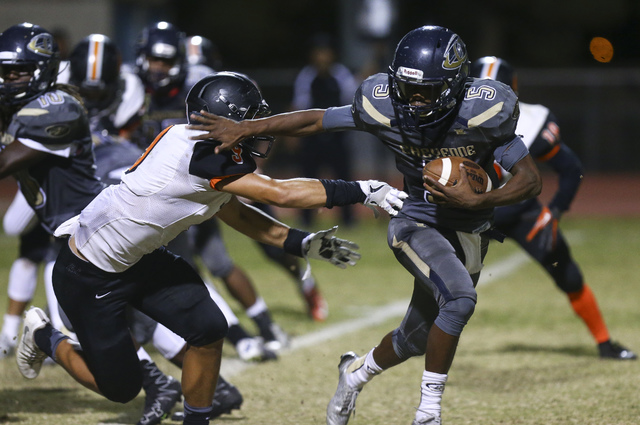Cheyenne's Deriontae Green (5) runs the ball to score a two-point conversion against Chaparral during a football game at Cheyenne High School in Las Vegas on Thursday, Oct. 27, 2016. Chase Stevens ...