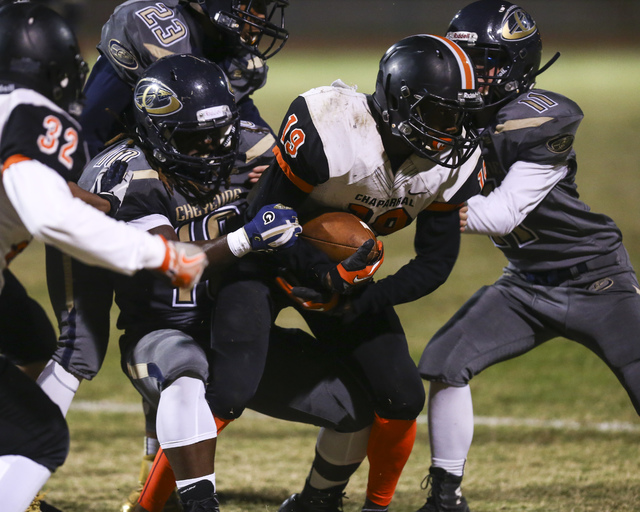 Chaparral's Jorge Bernal (18) is tackled by Cheyenne defense during a football game at Cheyenne High School in Las Vegas on Thursday, Oct. 27, 2016. Chase Stevens/Las Vegas Review-Journal Follow @ ...