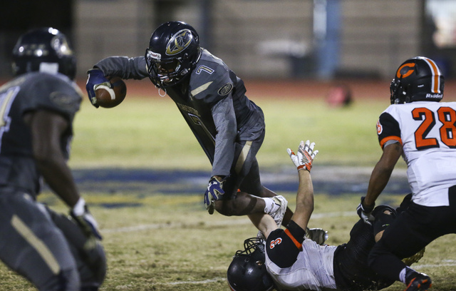 Cheyenne's William Federson (7) is tripped up after intercepting the ball during a football game against Chaparral at Cheyenne High School in Las Vegas on Thursday, Oct. 27, 2016. Chase Stevens/La ...