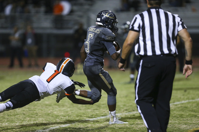 Cheyenne's Deriontae Green (5) scores a touchdown as Chaparral's Christian Thomas-Fulton (1) fails to tackle during a football game at Cheyenne High School in Las Vegas on Thursday, Oct. 27, 2016. ...