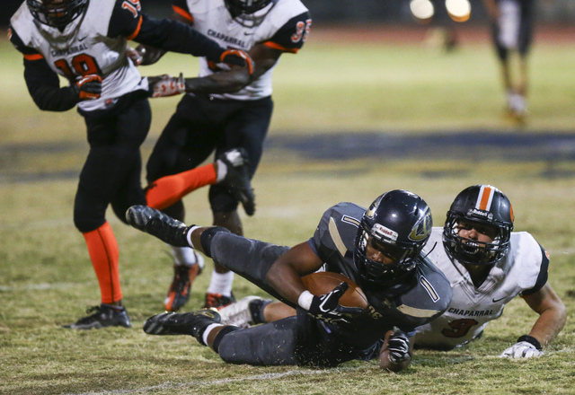 Cheyenne's Christian Thomas-Fulton (1) is tackled by Chaparral's Devin Gaddy (9) during a football game at Cheyenne High School in Las Vegas on Thursday, Oct. 27, 2016. Chase Stevens/Las Vegas Rev ...