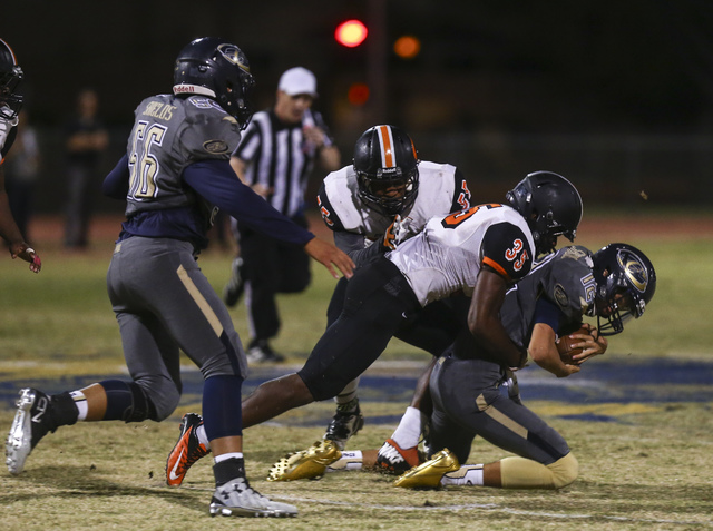 Cheyenne's Matthew LaBonte (12) is tackled by Chaparral's Shawn Nelson (35) during a football game at Cheyenne High School in Las Vegas on Thursday, Oct. 27, 2016. Chase Stevens/Las Vegas Review-J ...