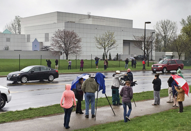 People stand outside the entertainer Prince's Paisley Park compound in Chanhassen, Minn., in April.  (Jim Gehrz/Star Tribune via AP)