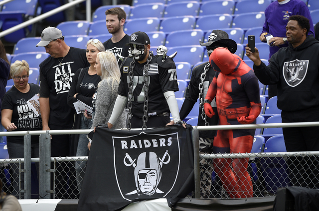 Oakland Raiders fans watch warm ups before an NFL football game against the Baltimore Ravens, Sunday, Oct. 2, 2016, in Baltimore. (AP Photo/Nick Wass)