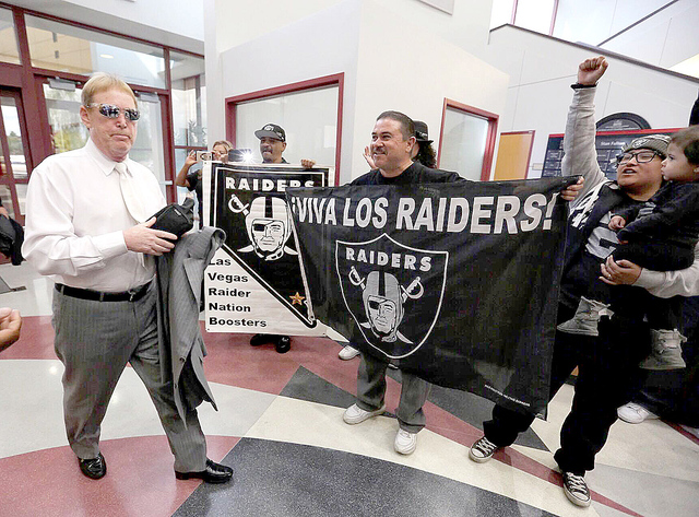Oakland Raiders fans greet team owner Mark Davis as he arrives at the Stan Fulton Building on the UNLV campus for the Southern Nevada Tourism Infrastructure Committee meeting, Thursday, April 28,  ...