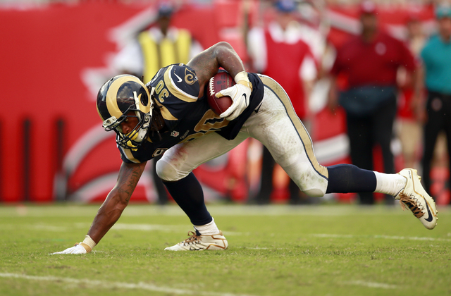 Los Angeles Rams running back Todd Gurley (30) runs the ball against the Tampa Bay Buccaneers during an NFL football game, Sunday, Sept. 25, 2016, in Tampa. The Rams won the game 37-32.    (Jeff H ...