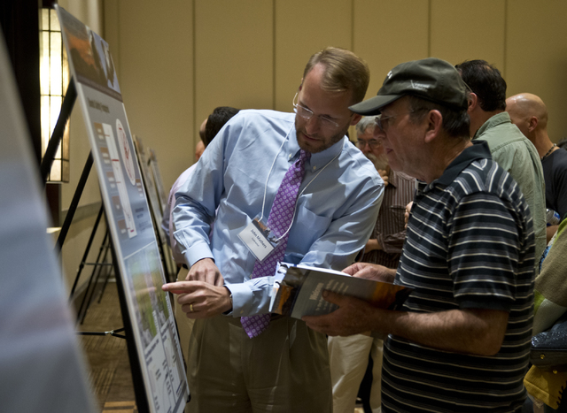 Ben Riedel, right, speaks with John Mathers during the public scoping meeting for the proposed expansion of the Nevada Test and Training Range at the Aliante hotel-casino in North Las Vegas on Thu ...