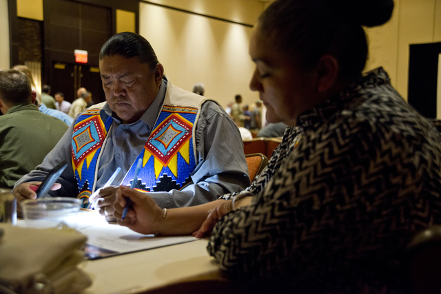 Gregory, left, and Shanah Anderson of the Las Vegas Paiute Tribe fill out public comment forms during the public scoping meeting for the proposed expansion of the Nevada Test and Training Range at ...