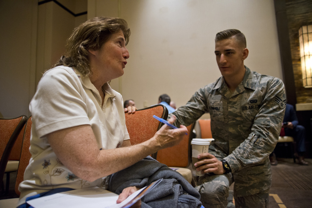 Dorothy Shuey, left, speaks with Senior Airman Joshua Reinholz during the public scoping meeting for the proposed expansion of the Nevada Test and Training Range at the Aliante hotel-casino in Nor ...