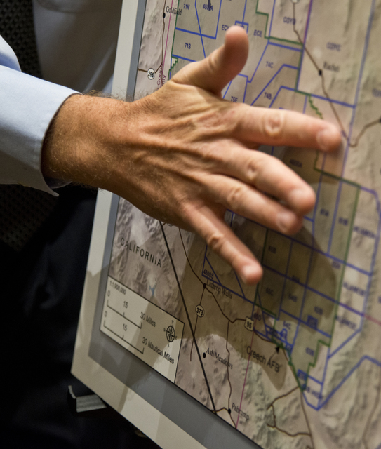 Project director Mike Ackerman gestures at a map of the proposed expansion of the Nevada Test and Training Range during a meeting with the public at the Aliante hotel-casino in North Las Vegas on  ...