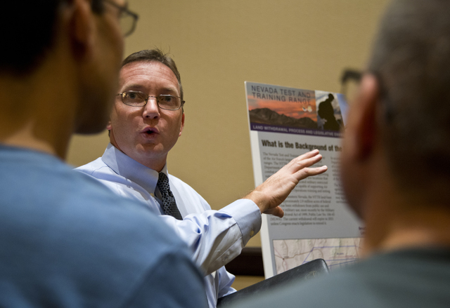 Project director Mike Ackerman speaks with members of the public during the scoping meeting for the proposed expansion of the Nevada Test and Training Range at the Aliante hotel-casino in North La ...
