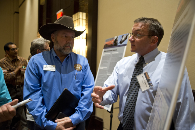 Project director Mike Ackerman speaks with Brett Jefferson of the Fraternity of the Desert Bighorn during the public scoping meeting for the proposed expansion of the Nevada Test and Training Rang ...