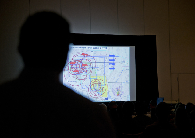 Project director Mike Ackerman watches an informational video during the public scoping meeting for the proposed expansion of the Nevada Test and Training Range at the Aliante hotel-casino in Nort ...