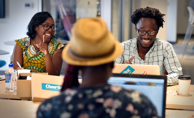 Tamar Lucien, from left, Latasha Dardin and Kwame Ampem work at the University of Phoenix's new RedFlint experience center Monday, Oct. 10, 2016, in downtown Las Vegas. The 11,000 square-foot educ ...