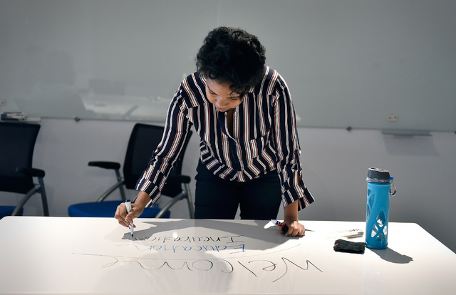 Managing director Shavonnah Tira Collins, of University of Phoenix's new RedFlint experience center, speaks of the upcoming opening as she makes notes on a writable table Monday, Oct. 10, 2016, in ...
