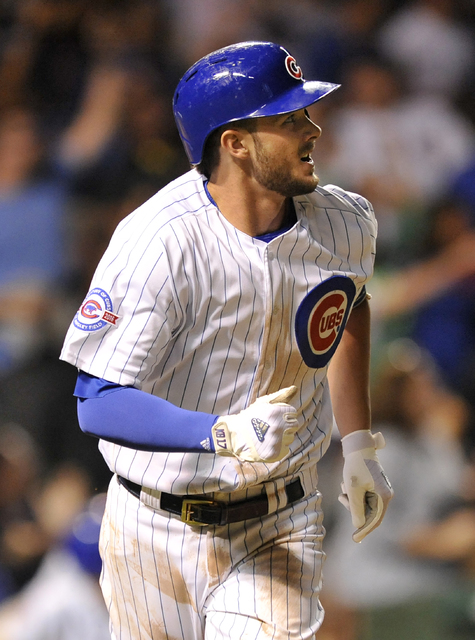 Chicago Cubs' Kris Bryant watches his two-run home run during the seventh inning of a baseball game against the Cincinnati Reds, Wednesday, Sept. 21, 2016, in Chicago. (Paul Beaty/AP)
