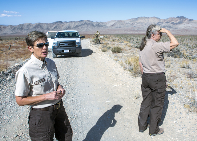 U.S. Fish & Wildlife Service refuge manager Amy Sprunger, left, and project leader Christy Smith views the  Desert National Wildlife Refuge on Friday, Sept. 30, 2016. The Air Force prepares to ...